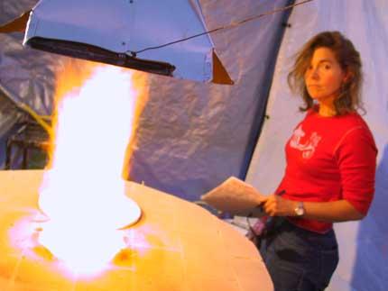 Barb Dunshee firing a kiln